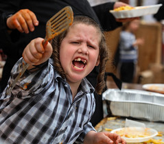 Give me some, Too! (ybiberman) Tags: israel jerusalem meahshearim passover boy portrait candid streetphotography scrapper teeth payot food