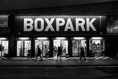 Boxpark (BrianEden) Tags: shopping night blackandwhite boxpark england london travel uk shoreditch fuji shippingcontainer brianedenphotography bw streetphotography fujifilm dusk unitedkingdom gb