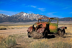 Forgotten (http://fineartamerica.com/profiles/robert-bales.ht) Tags: forupload haybales nevada oldcarandetc people photo places projects states transportation western phonecase oldcar modelt rustic landscape snow mountains rollinghills oldpickupoldtruck oldwestphotography schellbouonestation ponyexpress beautiful sensational spectacular scenicphotography awesome magnificent peaceful surreal sublime antique oldcollectable classictruck junk desert super rusty vehicle retro nostalgia vintage windshield chrome chassis collector grille headlight ford robertbales