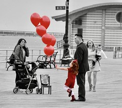"""My God, this reminds me Of when we were young"" - Adele (Lidiya Nela) Tags: notposed candid sonya6000 sony street streetphotography city urban parents boardwalk nyc newyork newyorkcity brooklyn coneyisland red balloons childhood partialcolor selectivecolor"