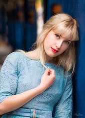 Hidden Secrets (Vijay Britto Photography) Tags: blue eyes gorgeous vintage beautifullady outdoorportraits naturallight blonde red lipstick strangers gaze nikon d750 85mm 18