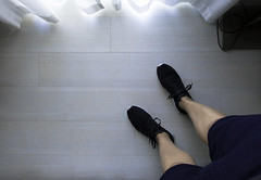 Hotel room light (jpl.me) Tags: availablelight window legs shoes trainers shorts