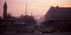 As Jersey as it gets. A smoggy purple sunset on the edge of Jersey City near Hoboken. An old church, a field of litter and the industrial early 20th century Lackawanna railroad building. A strong feeling of aging and abandonment prevails. July 1982 (wavz13) Tags: oldphotographs oldphotos 1980sphotographs 1980sphotos oldphotography 1980sphotography vintagephotographs vintagephotos vintagephotography filmphotos filmphotography oldbuildings abandonedbuildings industrial industrialphotos industrialphotography oldfactories vintagefactories oldhoboken vintagehoboken vintagebuildings 19thcentury oldconstruction depressing bleak noir noire dark jerseycityphotographs jerseycityphotos oldjerseycityphotography oldjerseycityphotos oldjerseycity vintagejerseycity vintagejerseycityphotography jerseycityhistory hobokenphotography hobokenphotos oldhobobokenphotography oldhobokenphotos urbanphotography urbanphotos urbanscenes cityphotography newjerseyphotographs newjerseyphotos oldnewjersey vintagenewjersey newjerseyhistory kodachrome oldslides vintagekodachrome oldkodachrome urbandecay urbanwasteland urbanblight vintageindustry oldindustry vintageindustrial oldindustrial vintagefactory oldfactory industrialjerseycity jerseycityfactories urban vintageurban hobokentrainterminal desolate