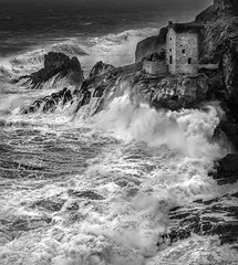 Exposed (Mick Blakey) Tags: swell coastsurf tidal rugged cornish coastpath rocky surf moody clouds cornwall blackwhite enginehouse shadows vista contrast roughsea mining rocks monochrome coastal coastline black seascape cliffs coast botallack white