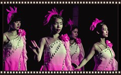 Pink Dancers (Explore) (missgeok) Tags: china lighting pink flowers ladies girls light colors beautiful closeup night composition spectacular fun costume lowlight pretty colours dancers dress singing angle dancing artistic candid performance creative explore frame colourful framing framework filmstrip repetitions headpiece prettycolours entertainers dancetroupe yangtzerivercruise colourtones nikond90 pinkdancers