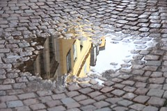 Puddle reflection in Gamla Stan, Stockholm