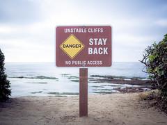STAY BACK (maida0922) Tags: ocean california sea cliff sign danger warning dof pacific sandiego bokeh horizon lajolla keepout lajollacove stayback em5 g20mmf17