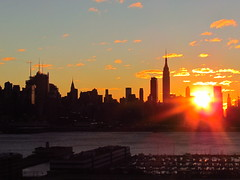 Midtown Sunrise 11/19 6 (quiggyt4) Tags: nyc newyorkcity red orange sun ny newyork yellow skyline skyscraper sunrise dawn newjersey glare horizon nj midtown esb hudsonriver empirestatebuilding wtc hudson gothamist timewarnercenter weehawken hudsoncounty ronpaul freedomtower ows occupy 5photosaday 1wtc hudsoncountynj occupywallstreet