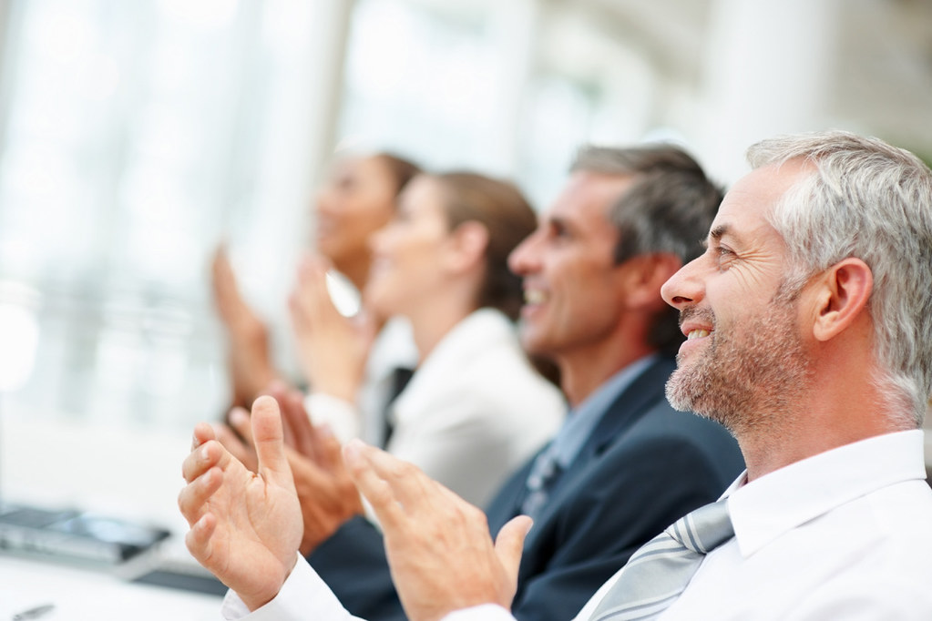 Group of happy business people clapping by tec_estromberg, on Flickr