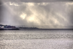 Distant Rain (Andy Tee) Tags: sun sunlight rain river shower rays cloudscape mersey