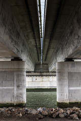 Under the bridge (BasLoo) Tags: under bridge botlek brug rotterdam port highway road speedway dark rocks lines line light pilar pilars water maas river minimal minimalism simple canon eos 6d canon6d dslr 50mm ef50mm prime lens 114 f14 usm photography