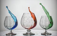 My cups spilleth over..... (Melanie Bradley) Tags: highspeed motion glass liquid fluid