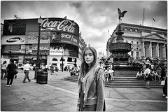 One Day... I'll Live in London (Steve Lundqvist) Tags: union jack england inghilterra uk english london londra groomed well street portrait dressed grooming shirt top womenswear jacket streetphotography cocacola piccadilly circus piazza square people statue gente sweatshirt hooded hood girl blonde hair cupido ad advertising pubblicità bw city urban center cite town british britain life style lifestyle outdoor