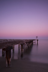 The Diver (Andrew.King) Tags: sunset sea pier person experimental photography wooden wood waves water ocean cyprus blur long exposure warm portrait composition nikon d7100 cokin nd filters tripod rust sand beach