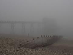 Foggy Pier (Nanooki ʕ•́ᴥ•̀ʔっ) Tags: selsey sussex fog foggy beach groyne mist winter dogwalker sea rnli