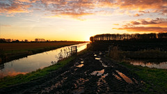 Who's Afraid Of The Mudmen? (Alfred Grupstra) Tags: clouds landscape mud sun sundown water oostwoud noordholland nederland nl nature sunset lake reflection outdoors sky river summer scenics ruralscene dusk beautyinnature tranquilscene sunlight tree sunrisedawn marsh