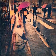 Or in rain? (tmbx) Tags: china beijing street rain umbrella reflection city