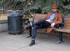 Blending In (Sherlock77 (James)) Tags: calgary downtown eauclaire streetportrait people man bench cowboyhat