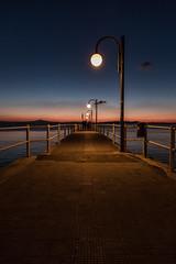 Pier at dusk (Massimo_Discepoli) Tags: pier dusk people sky lights shadows perspective evening trasimeno