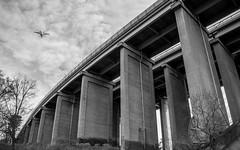Tranebergsbron (Stockholm) (fredrik.gattan) Tags: tranebergsbron bro bridge concret bw black white mono plane sky urban city stockholm kungsholmen traneberg sweden pillars