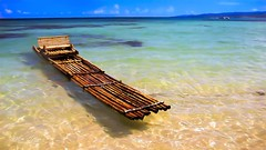 Bamboo Boat (mikederrico69) Tags: bamboo boat water beach ocean sea vacation trip travel carribean beaches colorful colors scenic scene jamaica summer sky nature nice meditation reflection exploration visit tropical tropic sunny boats shoreline relaxation