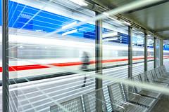 getting off to get on with it (Blende57) Tags: train trainstation platform platformshelter lines longexposure wideangle travel traveller woman speed motion blurred motionblur essencentralstation