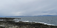Sutherland Coastlne from Tarbat Ness Point, Easter Ross, Easter Monday 2017 (allanmaciver) Tags: tarbat ness view sutherland mountains coastline rocks shore waves sea bitter cold wind grey cloudy allanmaciver easter east coast scotland