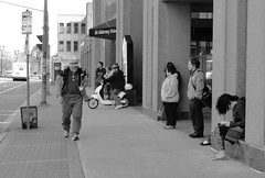waiting for the bus (thomas.erskine) Tags: bw bus spring ns may scooter landing sidewalk dartmouth alderney 2013 20130513dsc04729cropdesat