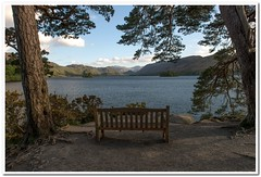 Lake with a view (Hugh Stanton) Tags: trees lake water bench derwent hills cumbria