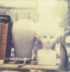 esther (davebias) Tags: polaroid doll fleamarket voltaire impossible castaways levelandtap