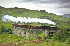 "Scottish Wonder: 62005 ""Lord of the Isles"" - Glenfinnan Viaduct (96tommy) Tags: uk bridge summer england mountain mountains west london car train movie photography coast scotland countryside flying photo flickr arch tour fort britain smoke united famous country hill great traction engine harry potter july fil rail railway kingdom arches games william lord class steam viaduct hills company trail transportation gb locomotive olympics railtour coal isles glenfinnan charter 2012 k1 mallaig jacobite gmaes 62005 trasnport wcrc 2y61"
