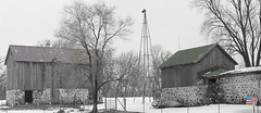 The old patriot with out buildings (WORLDS APART PHOTO) Tags: patriotic tower bladeless winter touchofcolor windmills windmillwednesday farmyard farming agriculture agriculturaldecay agriculturalbarns wisconsin sewisconsin monochrome outdoors stonework