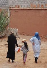 ladies' day out (SM Tham) Tags: africa morocco aitbenhaddou village women ladies girl walls
