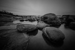 Stones (Edgar Myller) Tags: blackwhite stone rock coast kopparnäs rannikko finland black white bw night noon water polarizer filter sky dark deep thought
