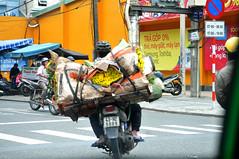 Flower power (Roving I) Tags: motorcycles flowers loads transport logistics helmets street danang vietnam