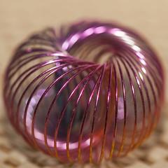 Pink Coil Bracelet Macro (cobalt123) Tags: canon5dmarkii arcs closeup coil flash glow glowing handheld home iridescent macro manual metal metallic pink practice scarlet spring
