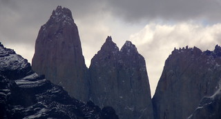 Rocky Andes mountain peaks under gloomy sky - Torres del Paine, Chile