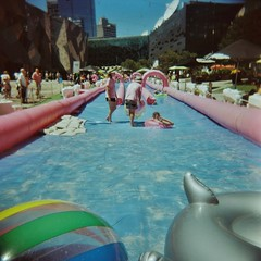 Fed Square waterslide (sonofwalrus) Tags: holga film lomo lomography scan melbourne victoria australia federationsquare slide waterslide ball city water swimmers summer