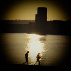 The last leg of the journey (JDWCurtis) Tags: cardiff cardiffbay bay water waterfront waterway reflection reflections silhouette sunset sun sundown people women woman girls vignette walk walking couple