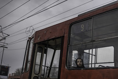 Urban Solitude (PetterPhoto) Tags: balkan balkantrail bosnia pettersandell petterphoto serbia belgrade beograd city urban tram boy red grey solitude loneliness candid street