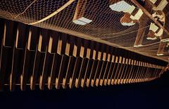 Overhanging eaves of the San-mon gate 2 (Tigra K) Tags: kyoto kyotoprefecture japan jp kyōtoshi kyōtofu 2012 architdetail color lattice night repetition rhythm wood pattern