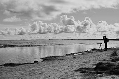 the photographer (doreenfischbach) Tags: blackwhite balticsea ostsee people candid clouds sky beach sea