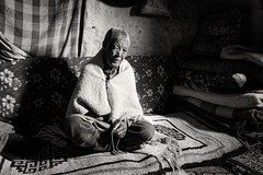 A Lifetime of Prayers (ZeePack) Tags: winter cold old woman sitting home village carpet candid beads wrinkles prayer religious praying spiritual rosary highaltitude crosslegged canon india himachalpradesh buddhist kibber 5dmarkiv wollens milestoneenterprisein milestoneenterprise monochrome