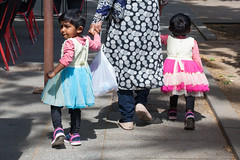 Pink & Blue, Barcelona (Geraint Rowland Photography) Tags: skirts children candidchildportraits poblesec barcelona spain europe streetphotography multicultural indianchildren pakistanchildren travel canon sunlight dresses fashion sunday walking cute geraintrowlandphotography