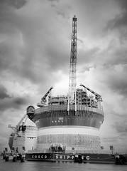 Xin Guang Hua (Giel Pieter) Tags: rotterdam rotjeknor portofrotterdam water harbour crane ship offshore xin guang hua bw hdr clouds sky