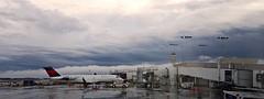 Aftermath (CaptainDFW) Tags: atl katl atlanta hartsfield jackson airport tarmac terminal concourse storm rain clouds canadair crj airplane airliner delta connection expressjet asa