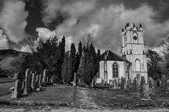 Glenorchy Church Graveyard (Brian Travelling) Tags: church kirk glenorchy parish gothic design architecture graves graveyard ancient mono blackandwhite black trees tranquil listedbuilding pentaxkr pentax pentaxdal peaceful peace serene landscape argyll argyllshire dalmally sky texture