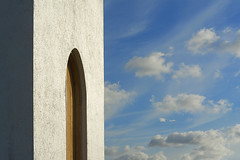 Door and clouds (Jan van der Wolf) Tags: map15526v chapel kapel clouds wolken door deur sky compositie composition leidschenveen art terpvanleidschenveen terp landart church