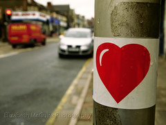 Street Heart (Posh Audrey) Tags: road street blue houses red white house love lamp lines car yellow shopping grey trafficlight sticker traffic heart post pavement parking cardiff sidewalk lamppost shops van kerb yellowline cathays crwysroad crwys kerbside