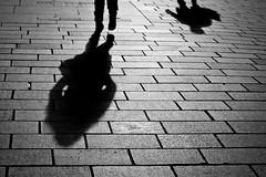 A Shadow of City Life (Leanne Boulton) Tags: life street city winter light shadow urban bw white black cold monochrome canon scotland blackwhite shadows path glasgow bricks scene human paving